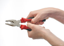 Young both hands gripping pliers isolated Stock Images