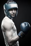 Young boxer. Posing over dark background Royalty Free Stock Images