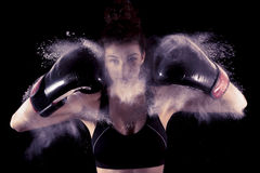Young boxer girl strikes up his gloves. In the powder Stock Photo
