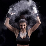 Young boxer girl strikes up his gloves Royalty Free Stock Photography