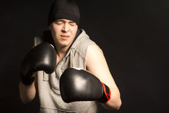 Young boxer grimacing in pain Stock Image
