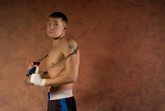 Young boxer in the gym with a skipping rope Stock Image