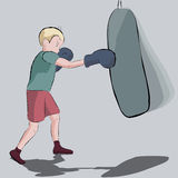 Young boxer hits a punching bag Stock Images