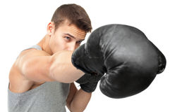 Young boxer making punch Stock Images