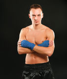Young boxer man isolated on black background Stock Photography
