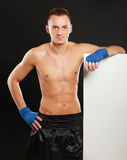 Young boxer man standing near board , isolated on Royalty Free Stock Photo