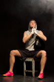 Young boxer praying fervently for a win Royalty Free Stock Images