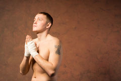 Young boxer praying before a match Stock Image