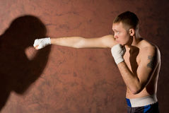 Young boxer punching his opponent Royalty Free Stock Photography