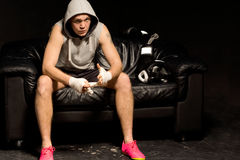 Young boxer sitting thinking and waiting Royalty Free Stock Photography