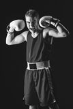 Young boxer sportsman on black background Stock Images