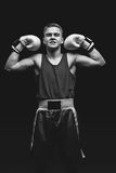 Young boxer sportsman on black background Stock Photography