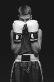 Young boxer sportsman on black background Stock Photos