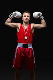 Young boxer sportsman in red sport suit Stock Photography