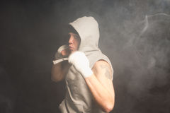 Young boxer about to throw a punch Royalty Free Stock Photo