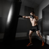 Young boxer trains on punching bag Stock Image