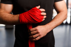 Young boxer tying red bandages Stock Image