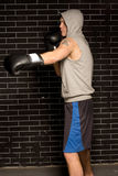 Young boxer working out against a brick wall Stock Photography