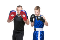Young boxer working out with coach stock photos