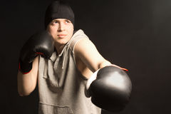 Young boxer working out in a training session Stock Images