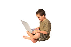 Young boy 1. Young boy working on his laptop computer stock images