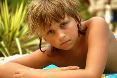 Young boy. Nine years old boy at the poolside Stock Photo