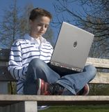 Young boy. With laptop Stock Photos
