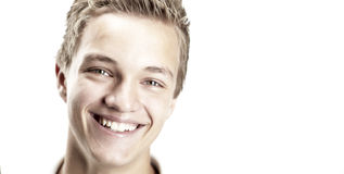 Young boy. A close-up shot of a boy smiling, isolated on white Stock Image