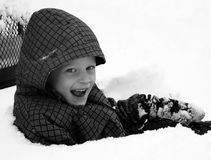 Young Boy. A young boy outside playing in the snow Stock Images