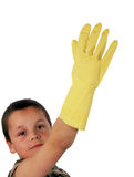 Young boy 13. Young boy wearing a yellow rubber glove stock image