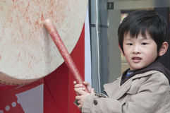 Young boy. Beats a drum young boy Royalty Free Stock Photo