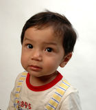 Young boy. An inquisitive young hispanic boy Stock Photography