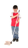 Young boy 15. Young boy doing his chore of mopping the floor Stock Images
