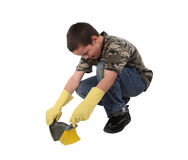 Young boy 16. Young boy doing his chore of cleaning the floor royalty free stock image