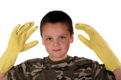 Young boy 17. Young boy wearing camouflage and rubber gloves for his chores Stock Photo