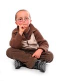 Young boy. Young boy sitting on a white background Royalty Free Stock Photo