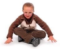 Young boy. Young boy sitting on a white background Royalty Free Stock Photography