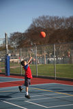 Young boy 18. Young boy mid-air while shooting a basketball at Mayfair Park stock photography