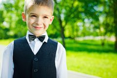 Young boy. In a shirt and vest in park Royalty Free Stock Images