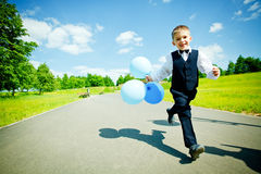 Young boy. Moving with balloons Stock Photos