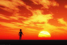 Young boy. Is watching the sunset Stock Image