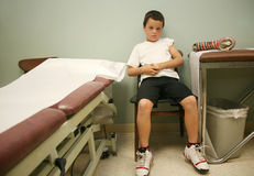 Young boy 23. Young boy right after he got his cast removed royalty free stock image