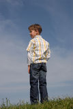 Young boy. A young boy in a field of grass Royalty Free Stock Images