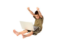 Young boy 3. Young boy very pleased with himself while he is using a laptop computer royalty free stock photos
