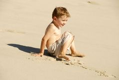 Young Boy. Playing at the beach Royalty Free Stock Photos