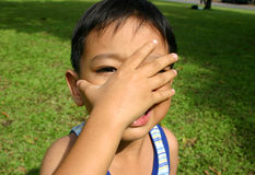 Young boy. Cover his face stock photo