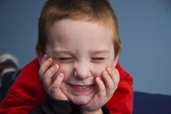 Young Boy 8083. Young boy leaning on elbows resting face on hands with his eyes closed Royalty Free Stock Photo