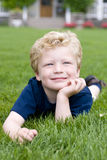 Young Boy. A young boy laying in the grass Stock Images