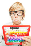 Young boy with abacus calculator stock images