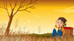 A young boy above the hill resting. Illustration of a young boy above the hill resting Stock Images